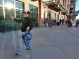 Diehard Rockies fan Justin Bozich (cq),34, of Arvada walks away from the Coors Field ticket...
