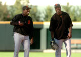 (DENVER, Co., SHOT 9/7/2004) The San Francisco Giants' Barry Bonds is three home runs short of...
