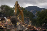 (Boulder, Colo., September 10, 2004)  Shawn Main operates an excavator to demolish a former...