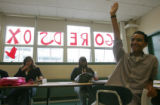 Roytel Montero (cq), 15, raises his hand in Humanities class at Fenway High School across the...
