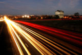 DM0778     Traffic streams down Sixth Avenue past the Federal Center in Lakewood, Colo. This is...