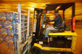 Brewery worker Mark Mullock moves two pallets of Miller Lite for shipping  Tuesday, October 9,...