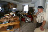 MJM289   Jim Britton (cq) looks over the belongings of his wife and his at their Adams County home...
