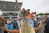 Bobbie Rubusch, of Theresa, lower, dances with friends Jenny Sandvick, of Milwaukee and JoAnne...
