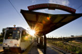 DLM3072  A light rail train pulls up to the Auraria West Station in Denver, Colo. The station,...