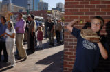 Colorado Rockies fan Charles Zablocki (cq, 10) throws a tennis ball against a wall as a line of...
