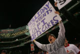 [ROX395] Rockies fan Chris Bianchi, 19, of Greenwich, Conn., holds a sign showing his support of...