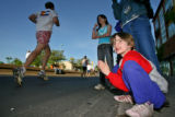 DLM1903  Maureen Aubrey, 7, of Aurora  and her family cheer on the runners as they pass by the...