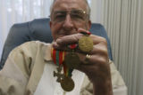 Herb Davis, 83, (cq) sits with some of his many medals at home at 3340 S. Oneida Way in Denver,...