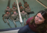 Coach of the year, Debbie Stewart, far right, with the boys team submerges as so many frogs, left...