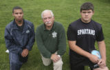 Left to right, boys runner of the year Jeremy Rankin, Rampart; boys coach of the year Dick Nye,...