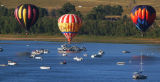 (LITTLETON Colo., August 29,2004)  Pilots fly their balloons  over some of the boats that came out...