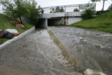 DLM3715  12:39 p.m. Time sequence showing flood waters rising over the wall that separates the...