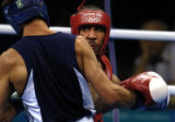 American light heavyweight Andre Ward, right,looks for an opening against opponent Magomed...
