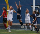 Hannah Peterson, 13, of Mullen (center) jumps in the air after scoring the winning goal in...