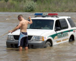 Bryan Peck a  helpful Rafter takes a tow strap out to Deputy Sgt. Rich Acree after Acree backed...