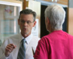 Executive Director of Denver Public Schools Retirement System, Norm Ruggles, left, talks to newly...
