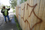 DLM0026 Gerald, the city of Greeley's one man graffiti removal crew uses a power washer to clean a...