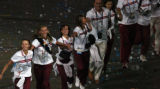 ***NOTE: Cannot identify country of origin****  Athletes dance along the floor of the stadium at...