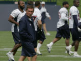 JOE056 Denver Broncos coach Mike Shanahan watches his team at the start of passing camp at the...