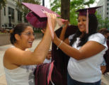 (DENVER, CO., MAY 19, 2004)  Veronica Solis, 20, right, helps Lupe Chavez, 18, with her cap after...