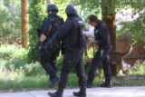 Denver police and a K-9 team  search for an armed suspect in the 5200 block of North Osceloa...