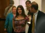 Michelle Berra, middle, walks out of Larimer County Court in Loveland, Colo., Thursday June 7,...