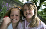 My Dad is a Hero Project. Kaitlyn Lempp  (cq), 10 right  hugs her younger sister Kaileen, 7.  ...