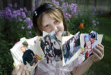 My Dad is a Hero Project. Kaitlyn Lempp  (cq), 10 holds a scrapbook she made of photos of her...