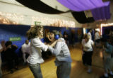 0638 Jess Mefford, CQ, 30, left, a program director at Laradon, dances with Daniel Gregg, 14, a...