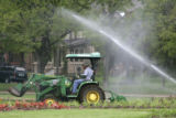 Suervisor, Breck English moves dirt for planting in Washington Park,  in Denver Colo. on Thursday,...
