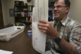 Tim O'Donovan, (cq) folds monthly ARC mailers at the Association for Retarded Citizens offices at...