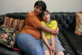 Danny Hoffenberg, 10, (cq) who has had two heart transplants, sits on the couch with his mom, Ana,...