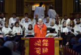 DLM4143  Father Michael O'Donnell leads a service for a service for part of the congregation of...