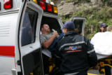 Davis Seals, 34, of Kansas is wheeled to a waiting ambulance Tuesday June 12, 2007, after he was...