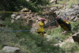 A emergency personal watches the movement of a rescue basket with Topeka, Kansas resident Davis...