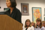(form left) Elizabeth Hyde (cq) , a mother of Boulder High School students speaks at the podium to...
