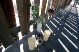 A makeshift memorial next to the pool outside the Rain Tree  Codominium Complex  in Aurora Tuesday...