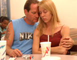 [Denver, CO - Shot on: 9/13/04] Angie Miller (right) is held by her husband Shannon Gaines (left)...