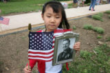 Sarah Appleton, 5 years old from Arvada, holds a picture of her grandfather, Major Frank Wright,...