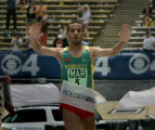 Ridouane Harroufi crosses the finish line to win the Men's Elite race on Memorial Day at the...