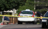 Arvada Police investigate the scene of a cab driver shooting Wednesday morning May 30,2007. A...