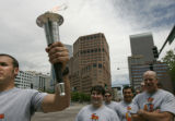 0138 Denver Police S.W.A.T.  member Chris Gruenther, CQ, 34, left, carries one of three torches...
