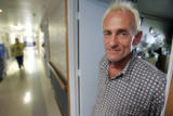 Rudy Ludemann (cq) stands in the doorway of his room at the Hospice of St. John's Thursday May 31,...