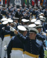(JOE694) - An unidentified Air Force Academy graduate points toward the stands at Falcon Stadium...