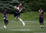 0041 Denver Broncos David Kircus drops a pass during practice at Dove Valley in Englewood Colo.,...