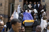 DLM6991  The casket of Yacob Gazaee is carried down the steps of the Ethiopian Orthodox Tewahedo...