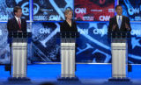 Democratic Presidential hopefuls Senator John Edwards of North Carolina (L) and Senator Hillary...