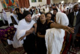 DLM6988  Muluberhan Gebre Selassie,center, falls back into the arms of her friends as she grieves...