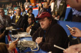 NEW YORK CITY, NY - AUGUST 30, 2004  Filmmaker Michael Moore takes a seat in the journalist...